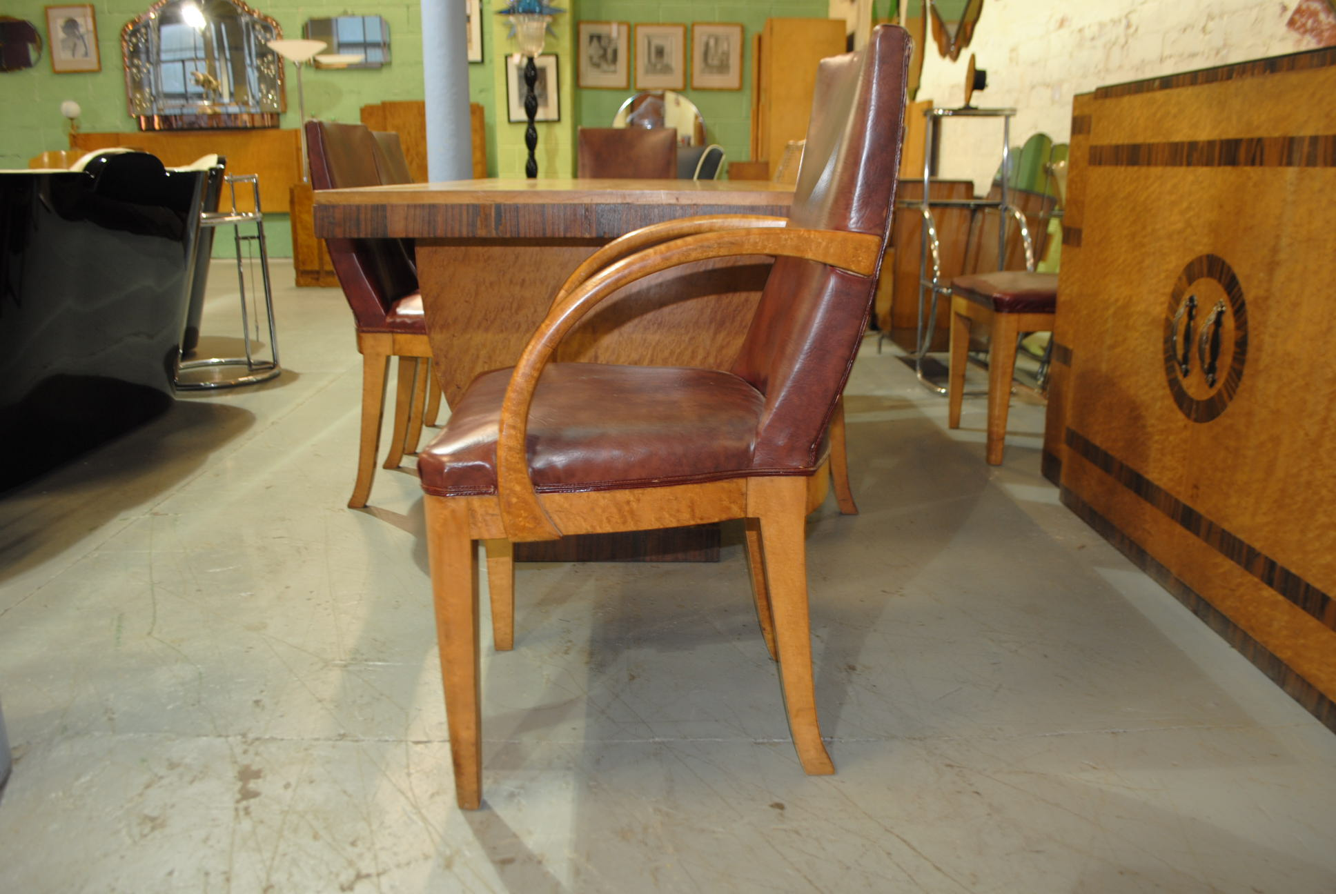 a fantastic original art deco dining table and 8 chairs with matching sideboard by maurice adams this is a fabulous and rare dining room suite hand made art deco dining table 8