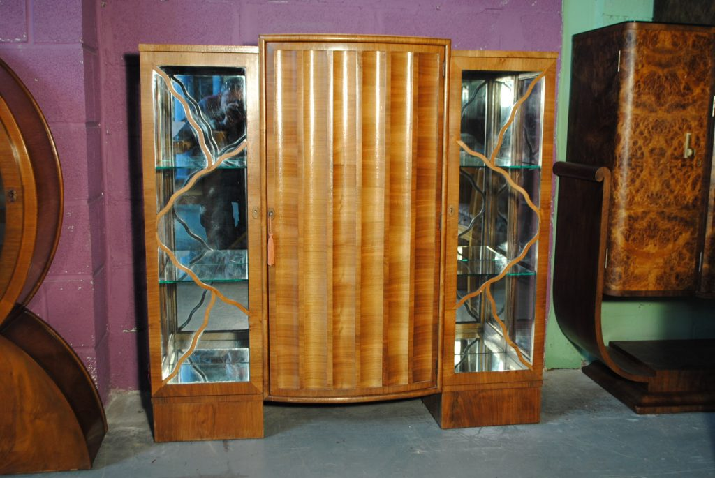 Walnut Display Cabinet with Mirrored sides and curved, scalloped door