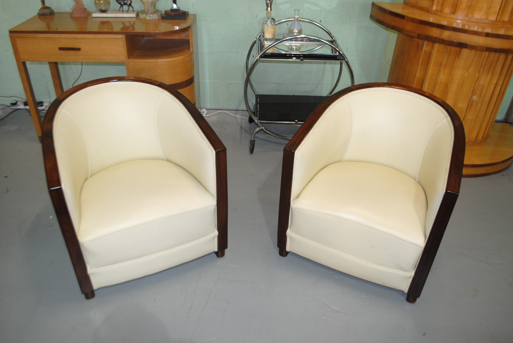 A Pair Of Original French Art Deco Club Chairs In Cream Leather And With  Walnut Backs.